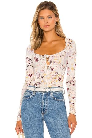 Free People Make It Easy Top in - Ivory. Size L (also in XS, S, M).