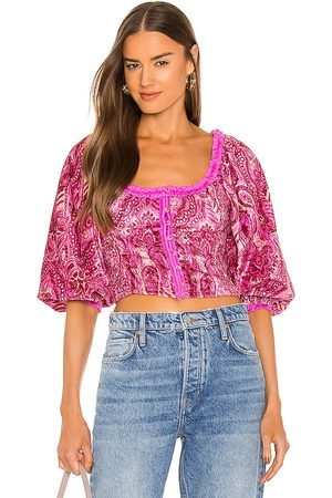 Free People Dare Me Velvet Blouse in - Fuchsia. Size L (also in M, S, XS).