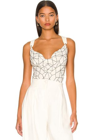 Free People Shine a Light Bodysuit in - Ivory. Size L (also in XS, S, M).