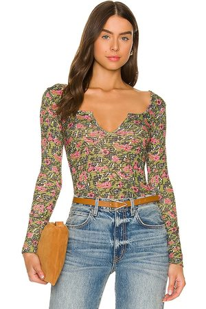 Free People Ciara Printed Layering Top in - Olive. Size L (also in XS, S, M).