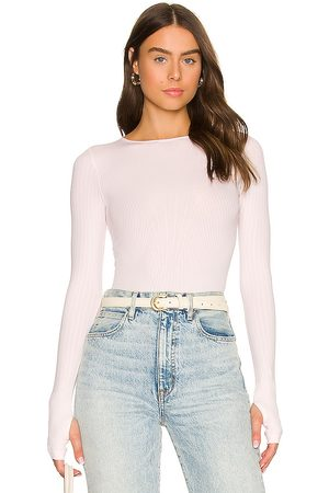 Free People Seams To Me Seamless Bodysuit in - Blush. Size M/L (also in XS/S).