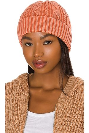 Free People Stormi Washed Cable Beanie in - Coral. Size all.