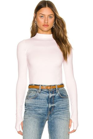 Free People Rocky Seamless Top in - Blush. Size M/L (also in XS/S).